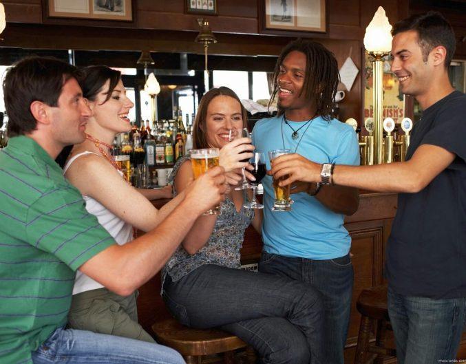 group of friends enjoying a beer at a park city bar