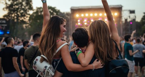 Friends at an outdoor music festival.
