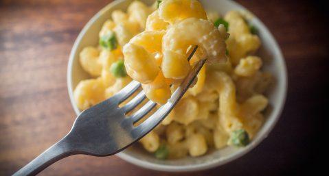 Mac n cheese on fork.