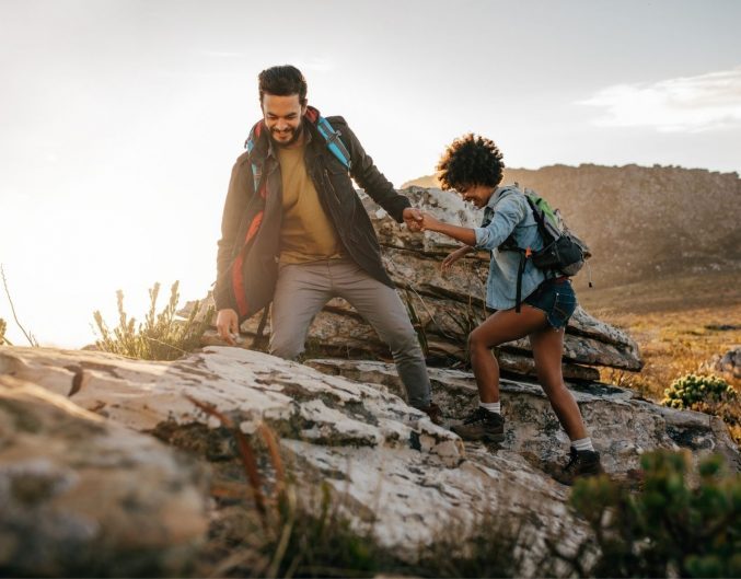Couple hiking through the mountains.